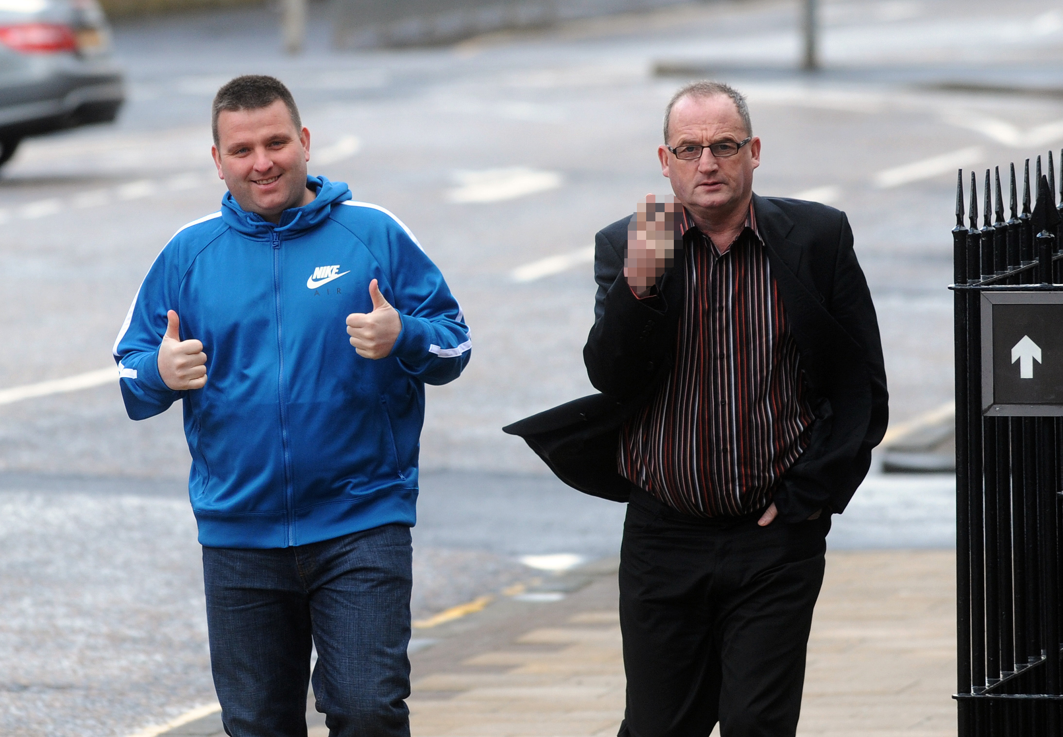 Badger baiting father and son, John Murray Snr and John Murray Jnr arriving at Hamilton Sheriff Court