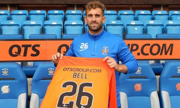 Cammy Bell with a Kilmarnock shirt