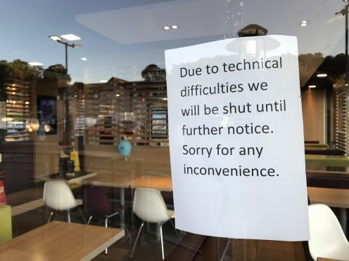 The sign placed on the window of McDonald's.