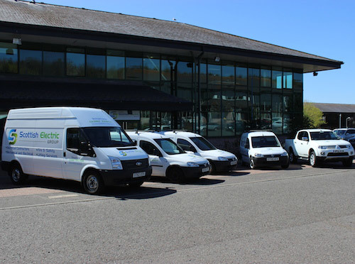 Scottish Electric Group vans outside the company's HQ.