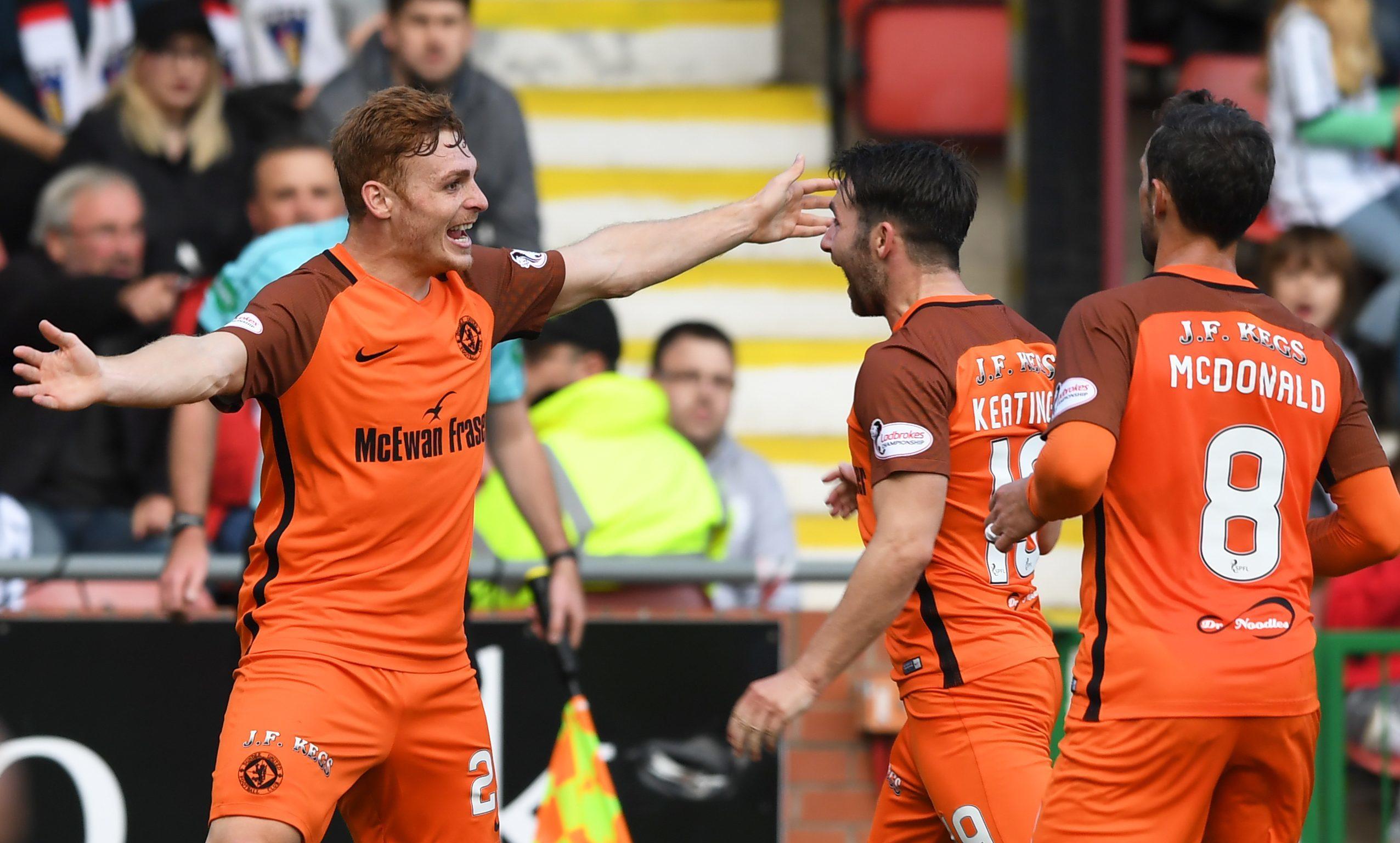 Fraser Fyvie celebrates after making it 1-0.