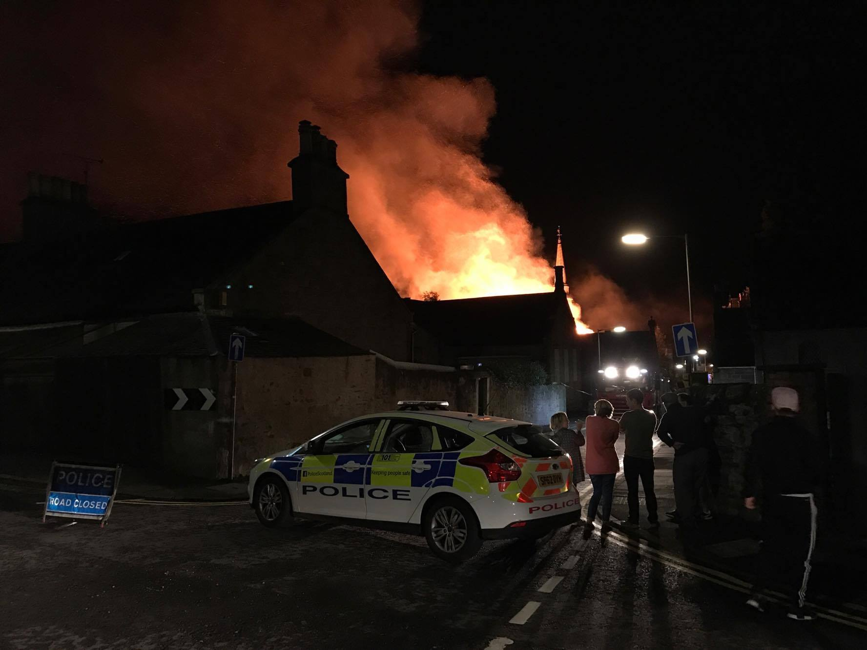 Locals look on as the fire ravages at the Lochee Old Parish Church