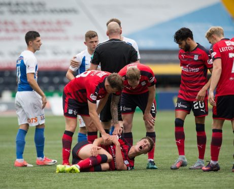 Jack Hendry is left in pain after being brought down by Kilmarnock's Calum Waters