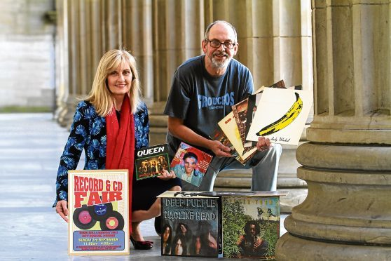 Caird Hall manager Susan Gillan and Groucho's owner Alastair Brodie show off some of the records on offer.