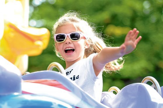 Five-year-old Grace McMurray enjoys a funfair held at Dundee Flower and Food Festival, which attracted thousands of visitors to Camperdown Park