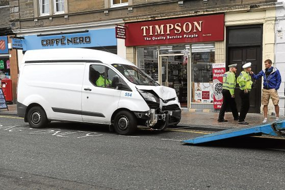 A damaged Dundee City Council van after a crash on Brook Street in Broughty Ferry
