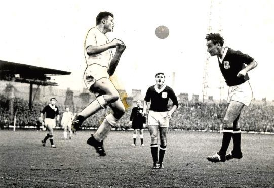 Dundee's Alan Gilzean gets in a header against Cologne at Dens in 1962.