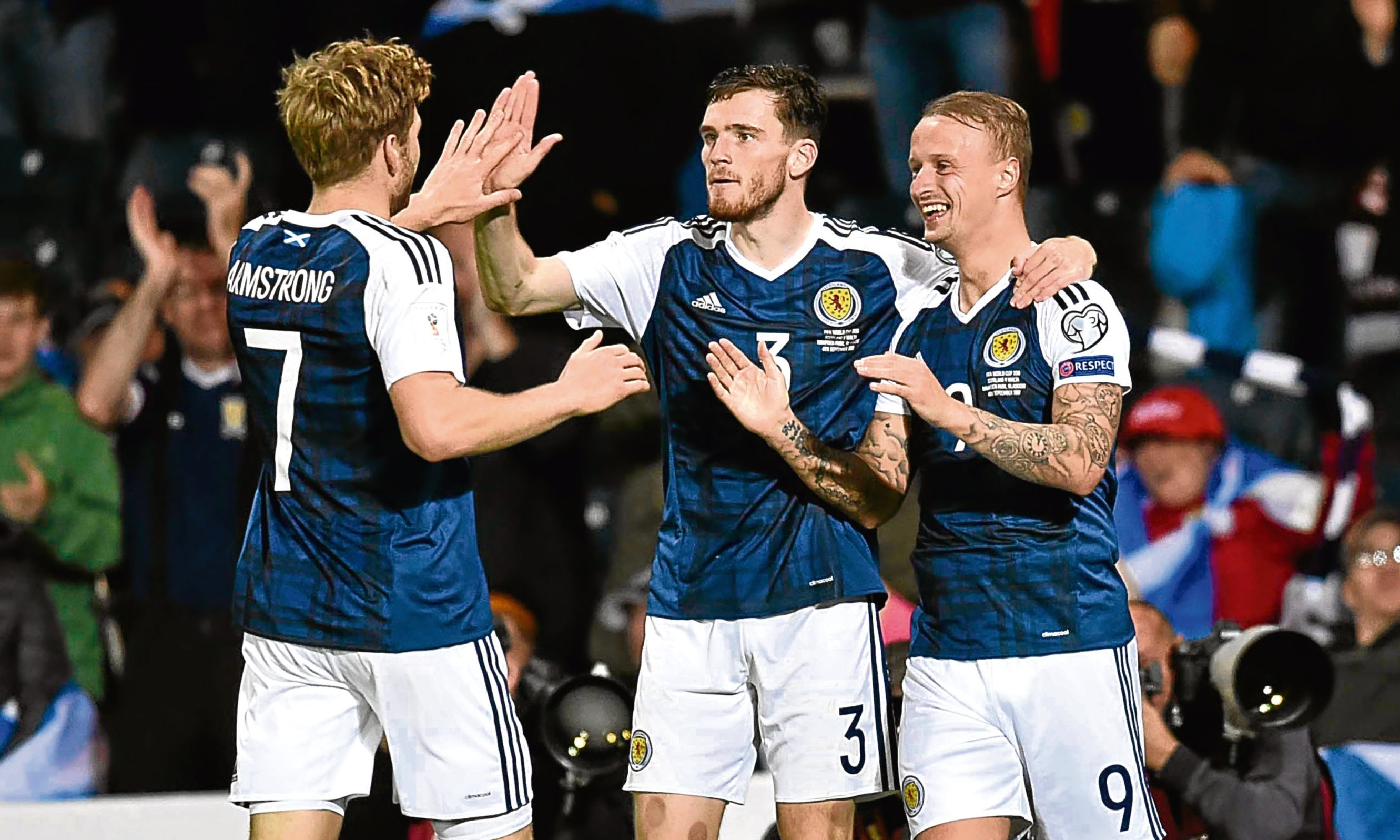 Scotland striker Leigh Griffiths (right) celebrates his side's second goal with Andrew Robertson (centre) and Stuart Armstrong against Malta on Monday night at Hampden.