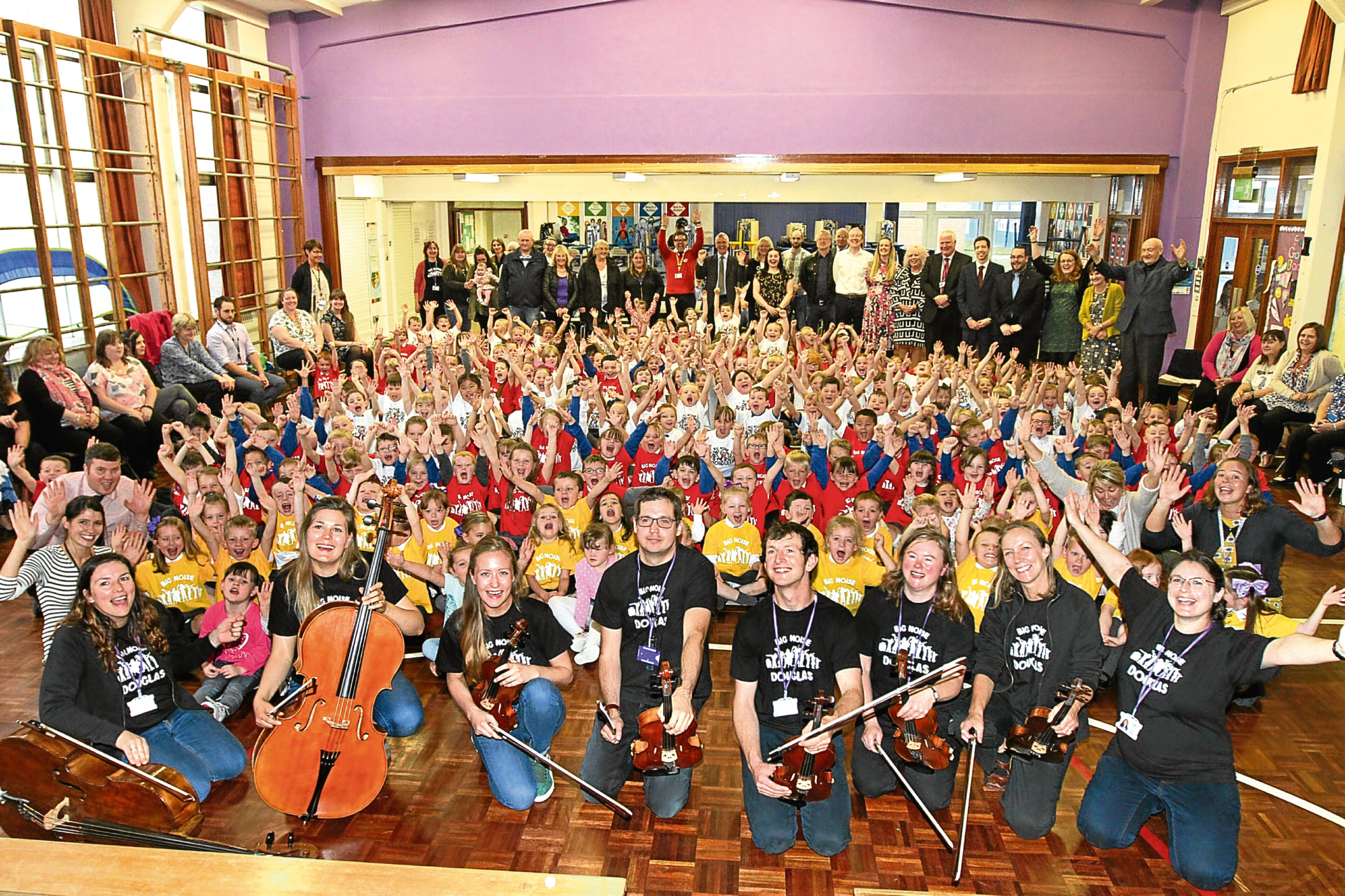 Pupils from St Pius and Claypotts Castle primaries with the Big Noise musicians.