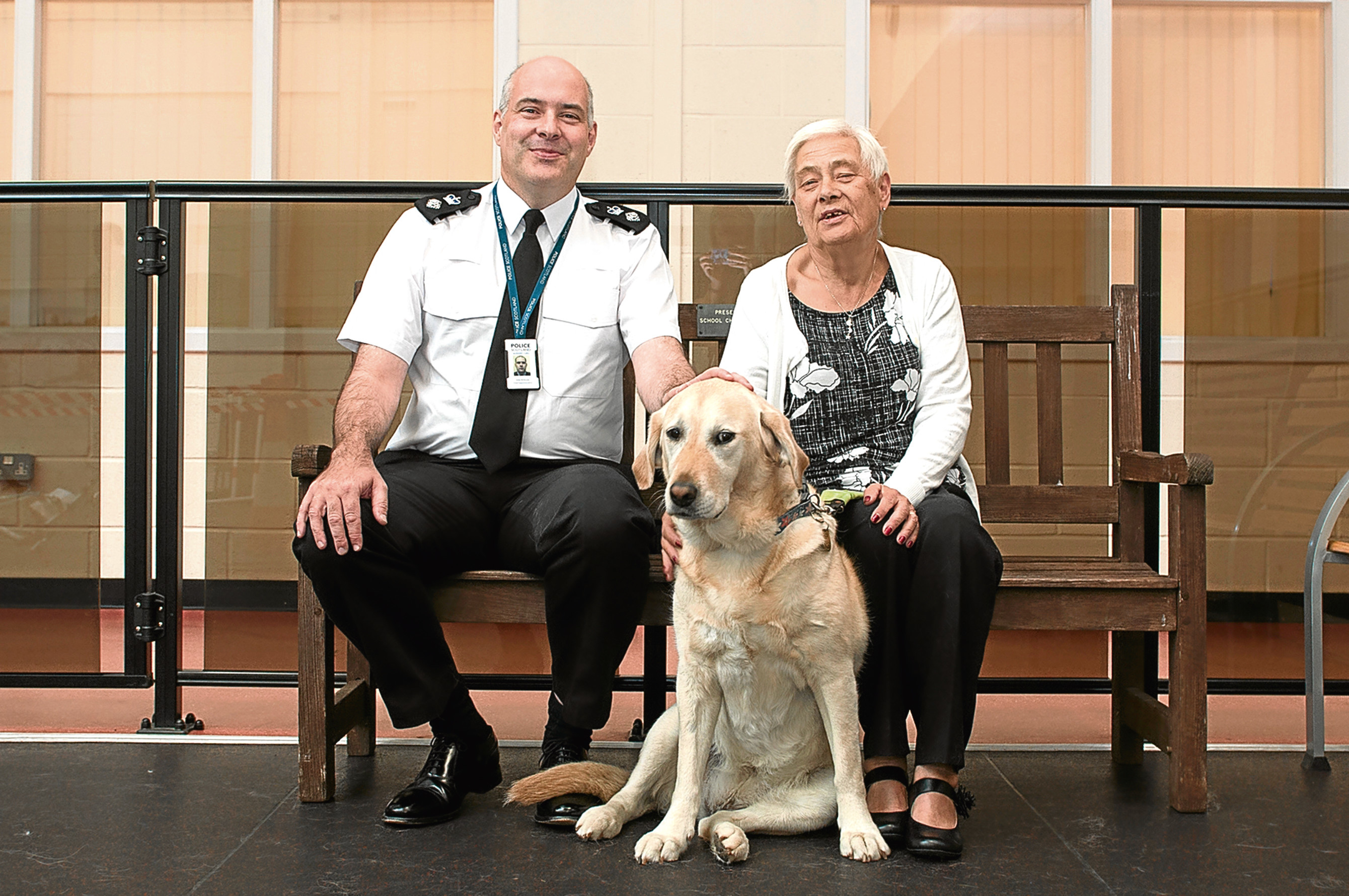 Picture shows Una with Elaine and Chief Superintendent McKenzie.