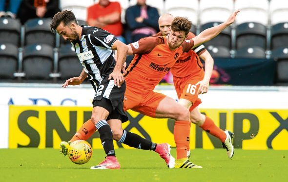 Dundee United's Stewart Murdoch — seen here in action against St Mirren's                       Stelios Demetriou — reckons other Championship sides up their game when they visit Tannadice.