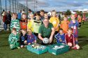 Ken Linton, of Dundee Foodbank (centre front), and Al West, of Leisure and Culture, with kids representing each of the teams taking part