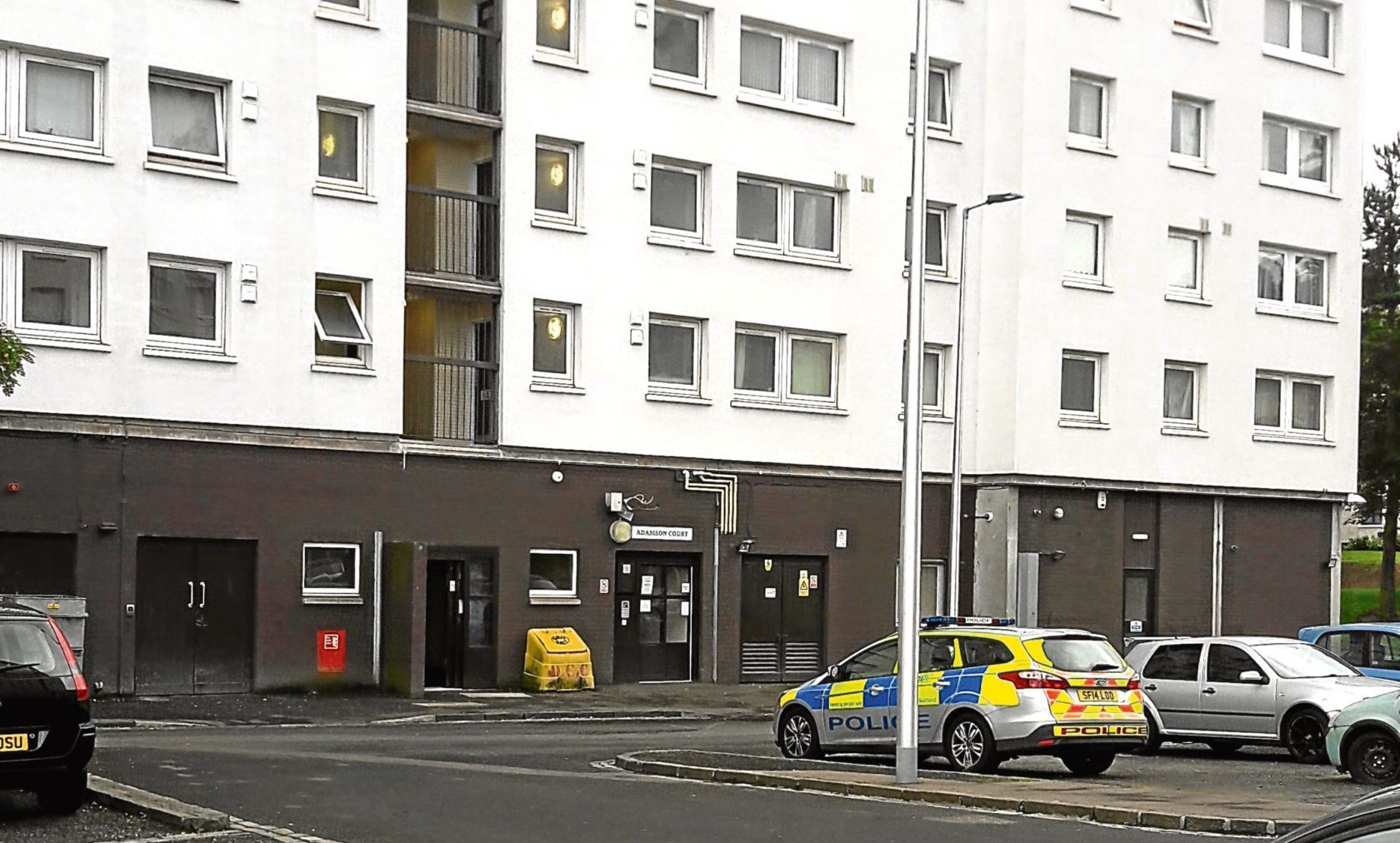 A police car outside Adamson Court, Lochee