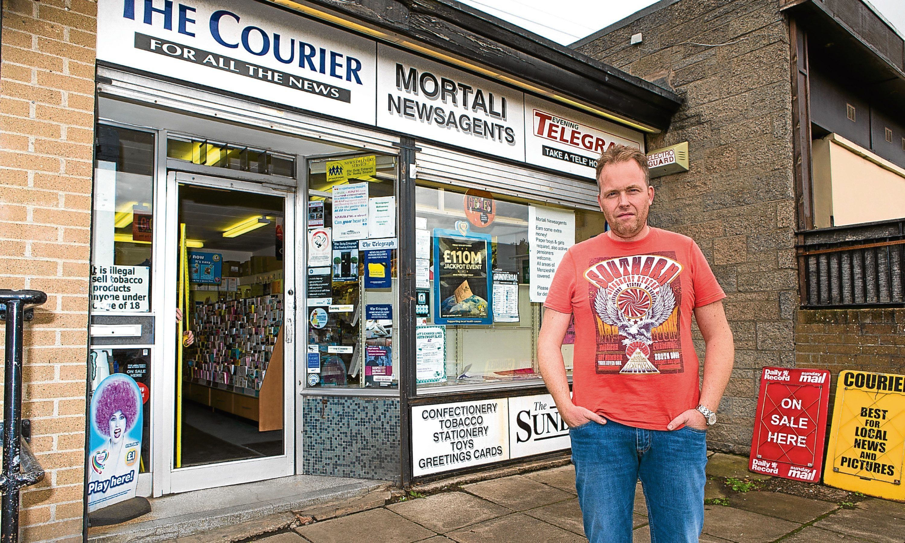 Shop owner Robbie Mortali (44) outside the newsagents