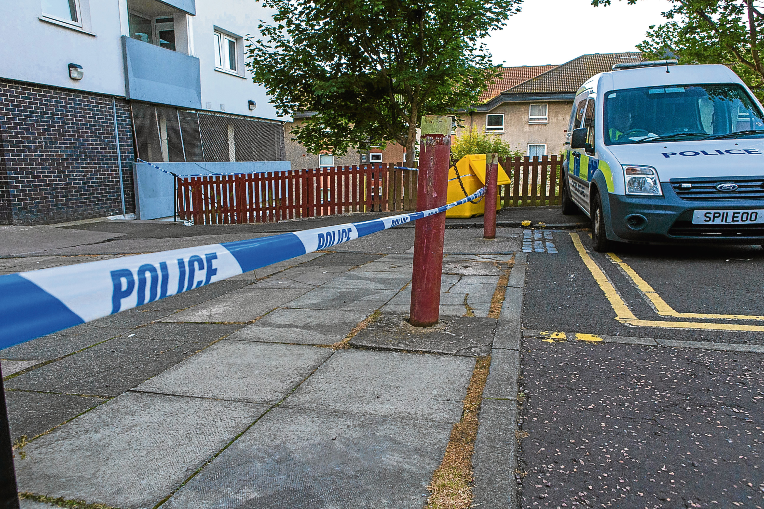 Police stationed outside flats at Hilltown Court