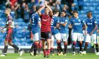 Cammy Kerr captained Dundee at Ibrox in Darren O'Dea's absence