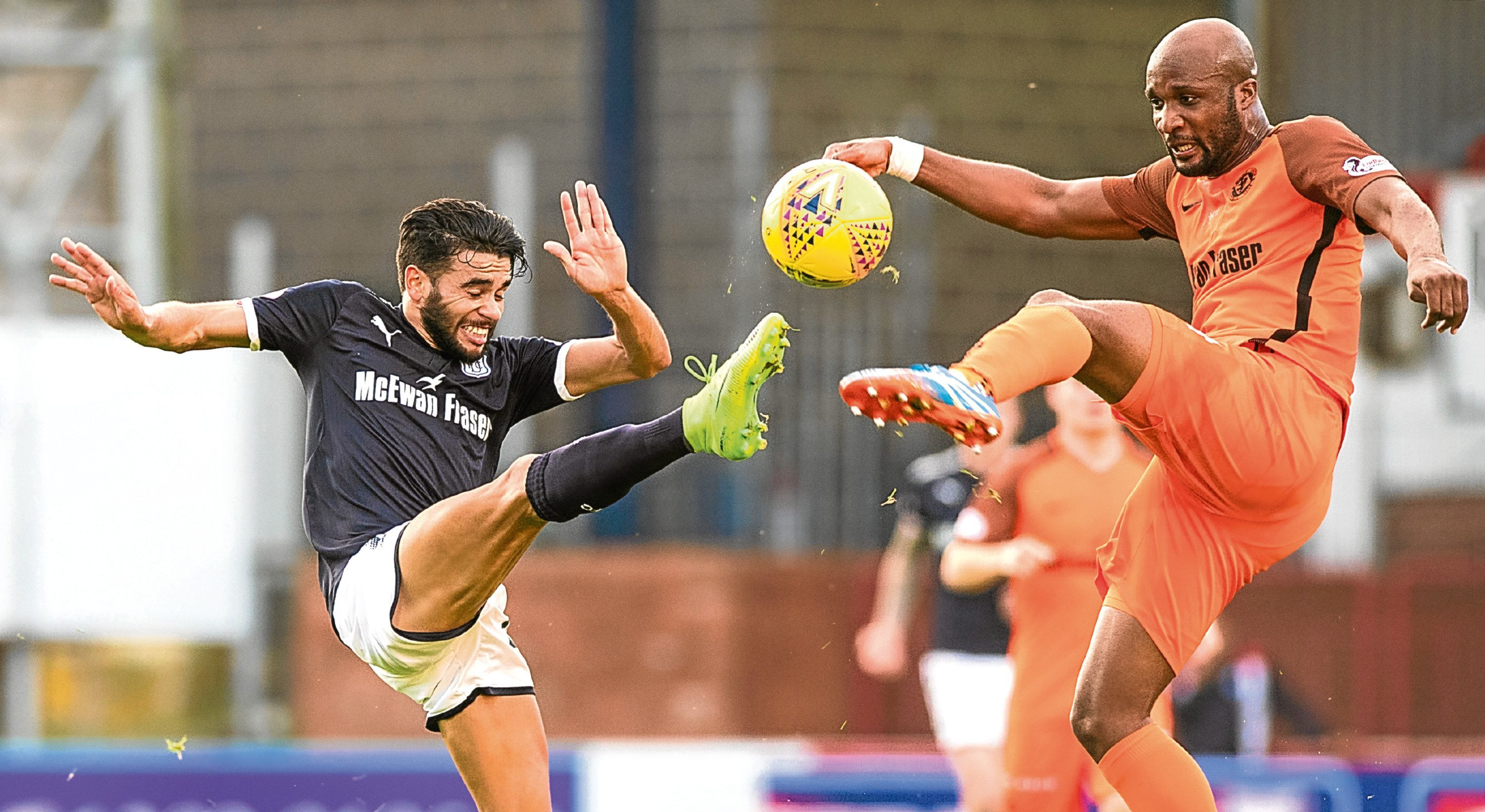 Dundee's Faissal El Bakhtaoui and Dundee United's William Edjenguele