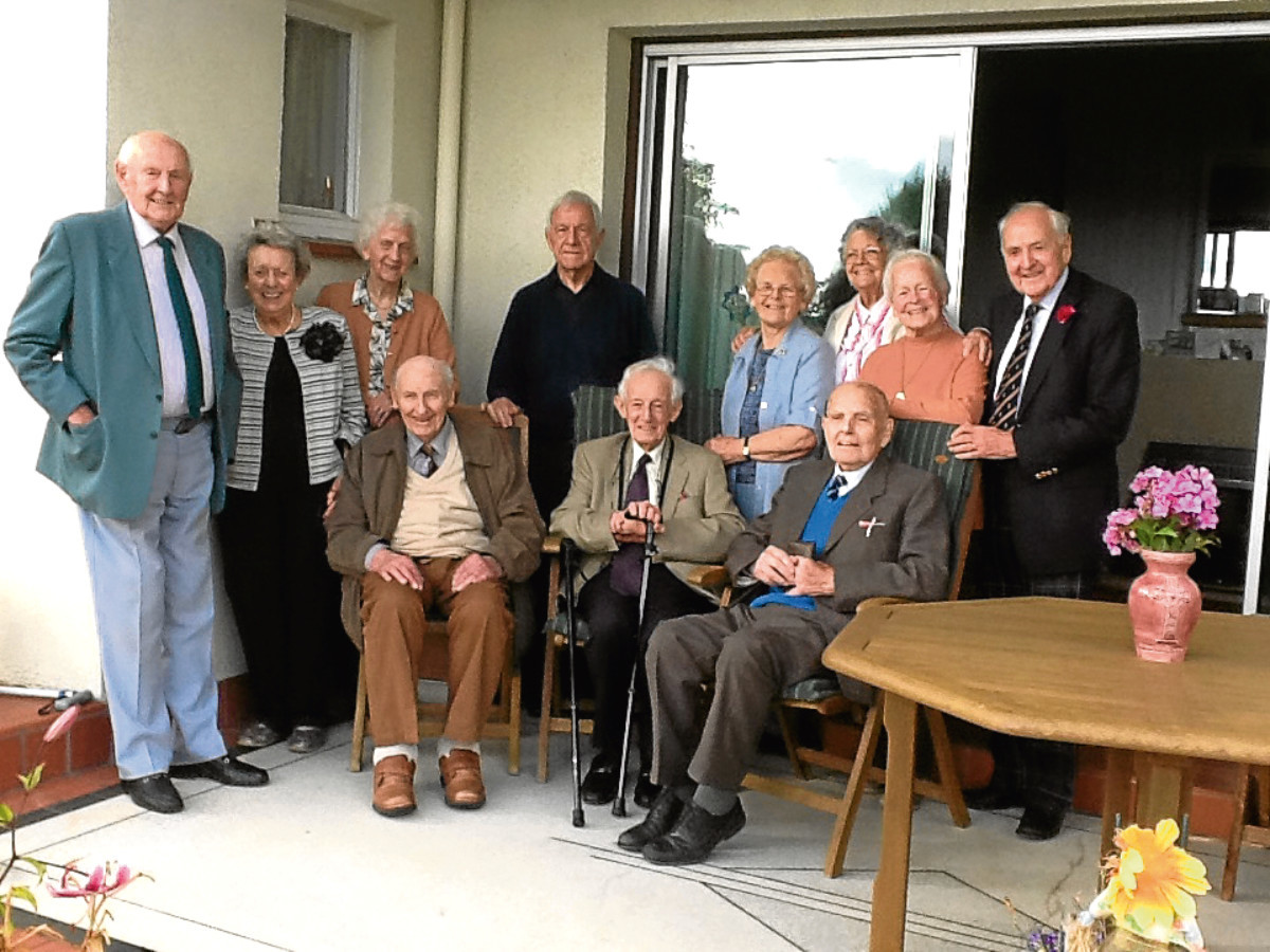 Picture shows (from left) Sandy Yates, May Livingston, Jessie Winton, Ford Mechan (South Africa), Catherine Gibson, Isobel Field (South Africa), Irene Beattie and Norman, all standing, with Reg Mulheron, David Paterson and Fraser Fyffe seated