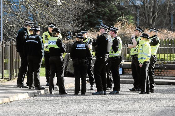 Officers on Drumlanrig Drive after the bodies of Julie McCash and David Sorrie were found