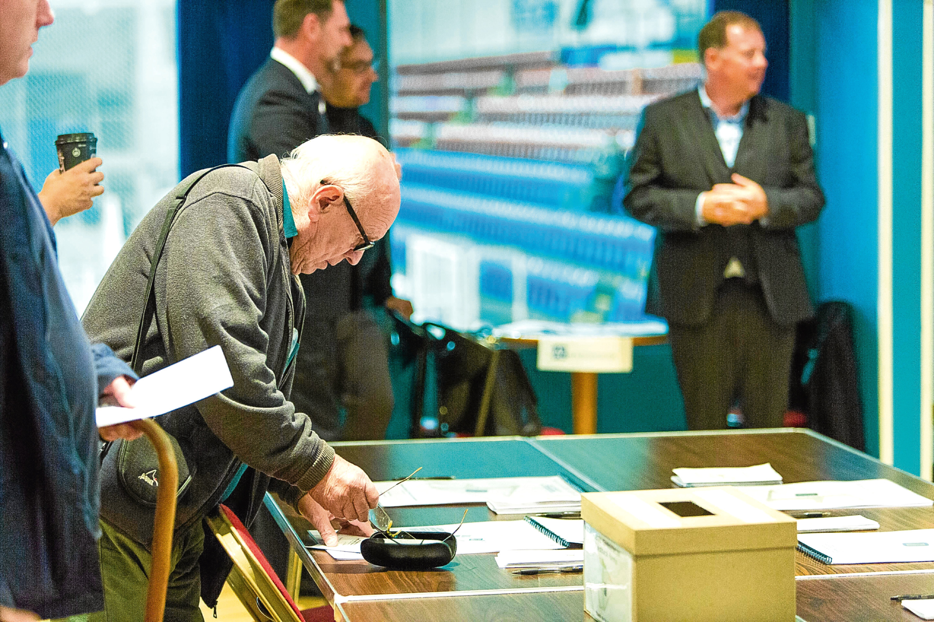 Members of the public look over proposals for a new Dundee Football Club stadium at a public consultation event.