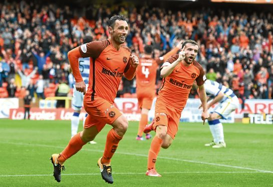 Striker Scott McDonald celebrates his 83rd-minute winner against Morton.