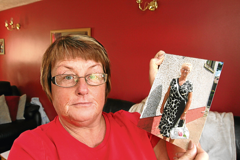 Karen Doogan holds a picture of her late mum Joyce