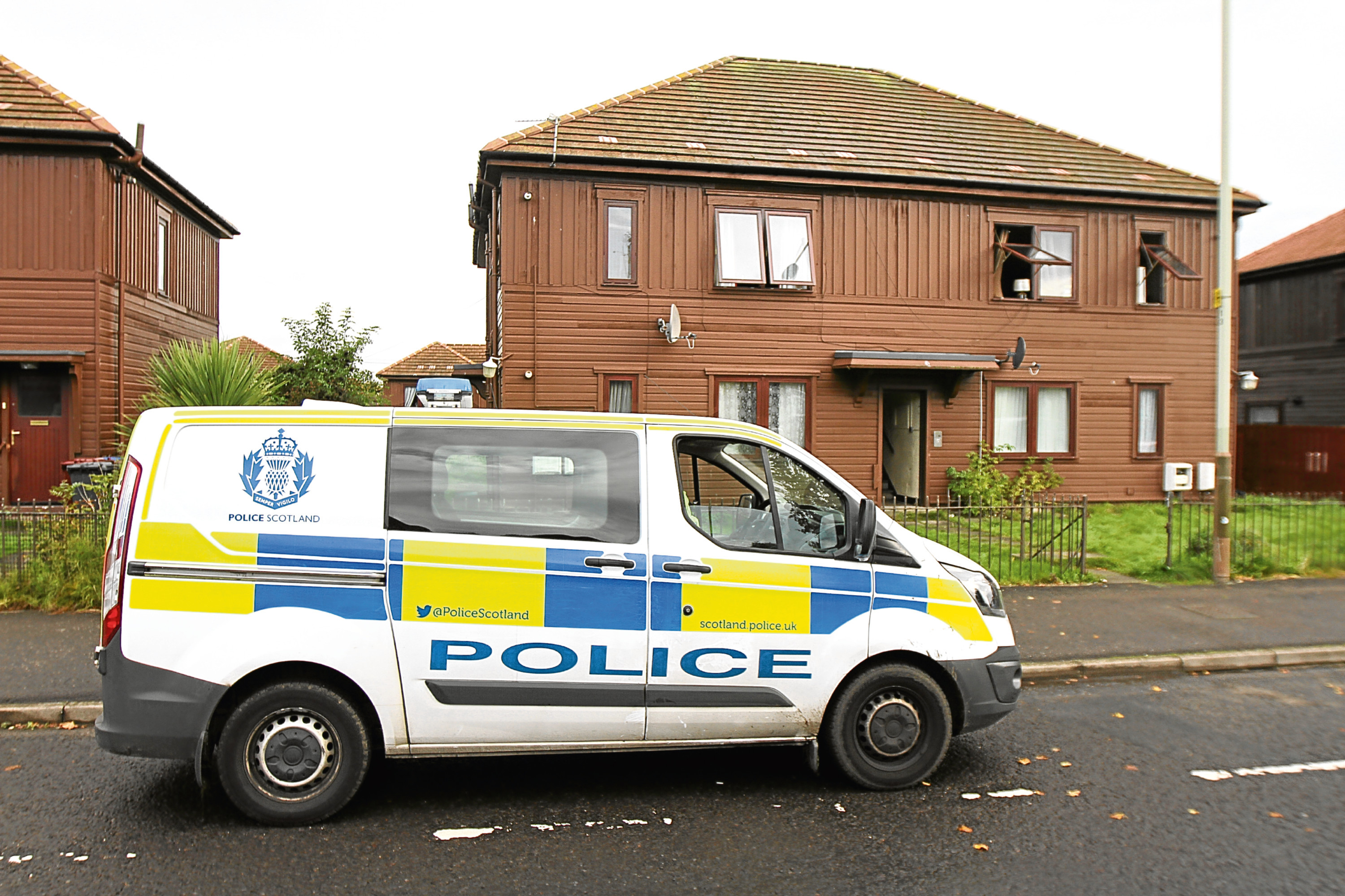 Courier/Tele News. Sarah/Scott story. The fire brigade had to rescue a person from a building on Glenconnor Drive, Dundee last night after their door in the communal stairwell was set alight. Neighbours were trapped in there home by the fire and thick smoke. Pic shows; police outside the house at 17/19 Glenconnor Drive. Friday, 29th September, 2017.