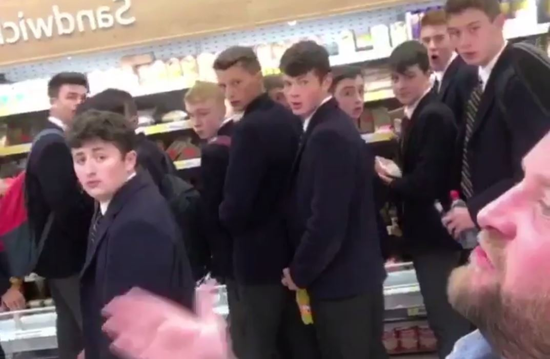 Arron Crascall sings in Dundee's Tesco Metro in front of High School of Dundee pupils