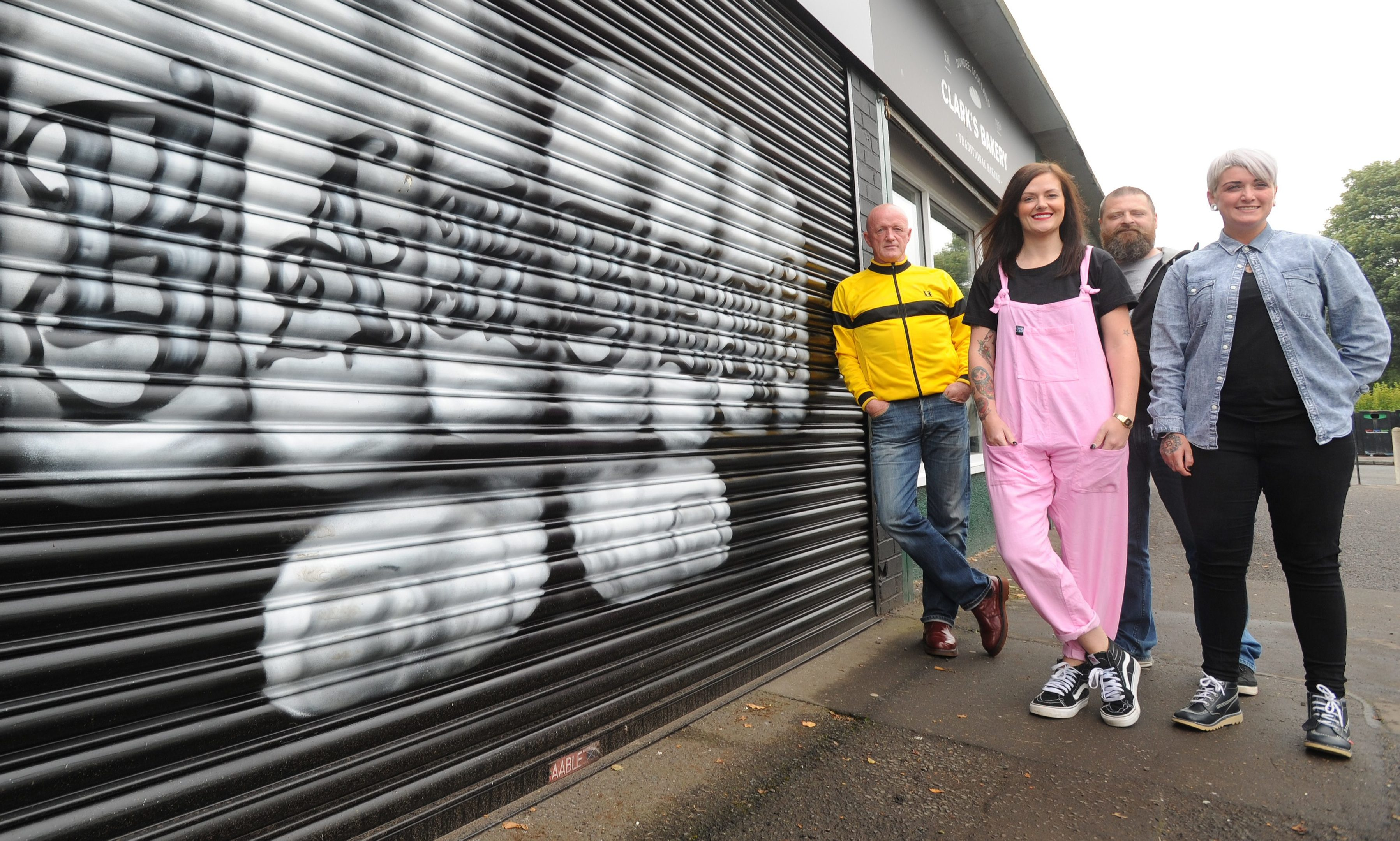 Stobswell street artist Gavin Guyan repainted the shutter doors with an eye-catching pair of knuckles