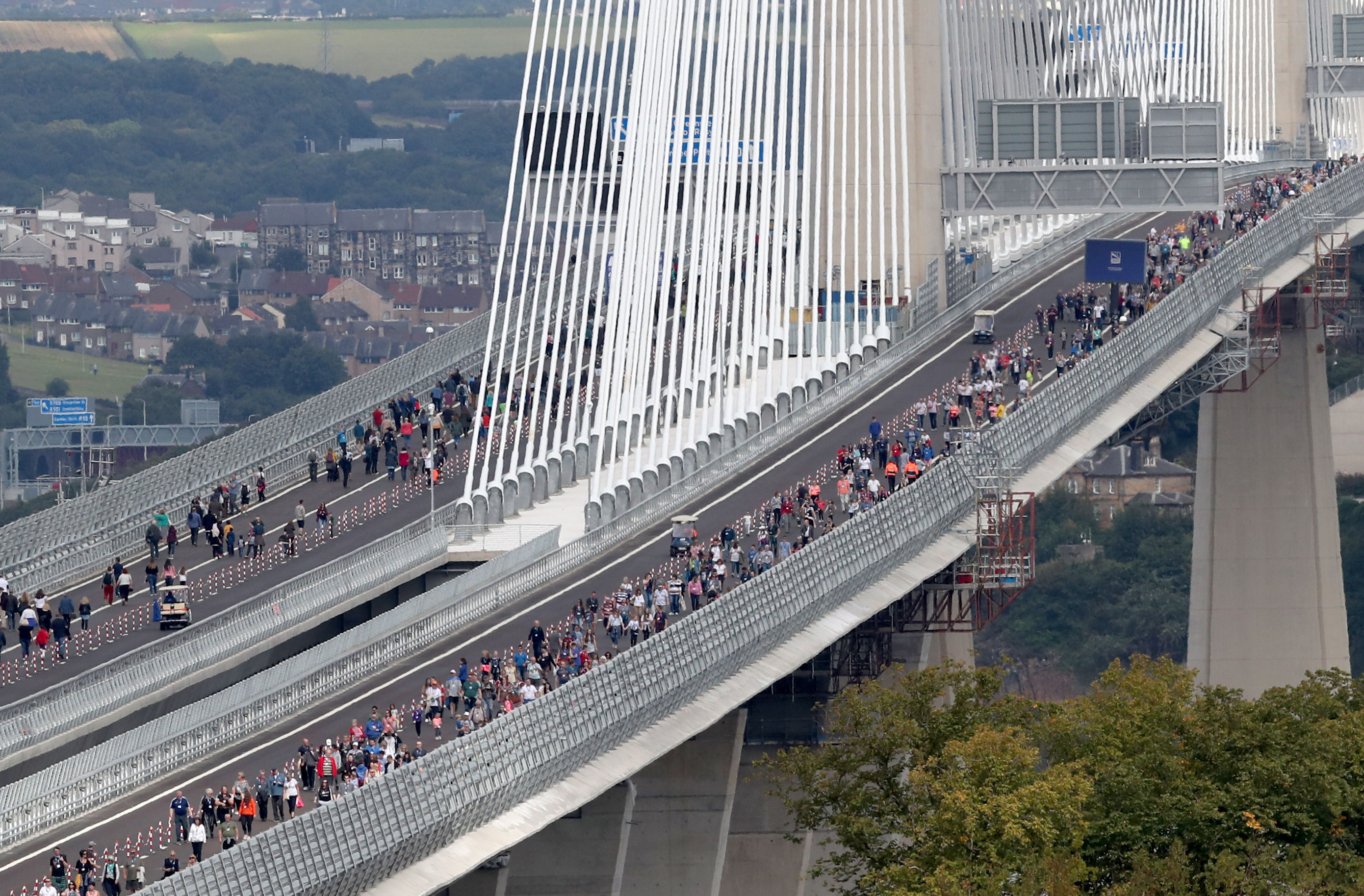 Competition-winners walk across the Queensferry Crossing during a one-off opportunity to cross the new 1.7-mile bridge by foot