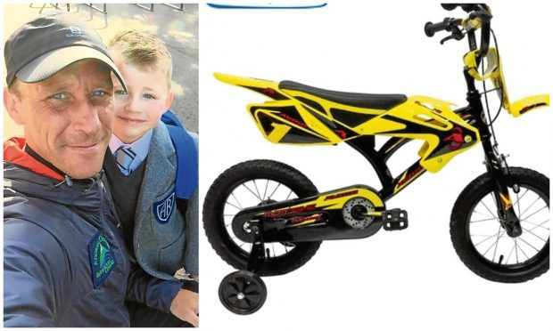 Andy with his son, AJ. The Avigo bike that was stolen from outside their home in Lister Court.