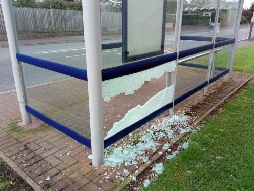 The smashed bus shelter.