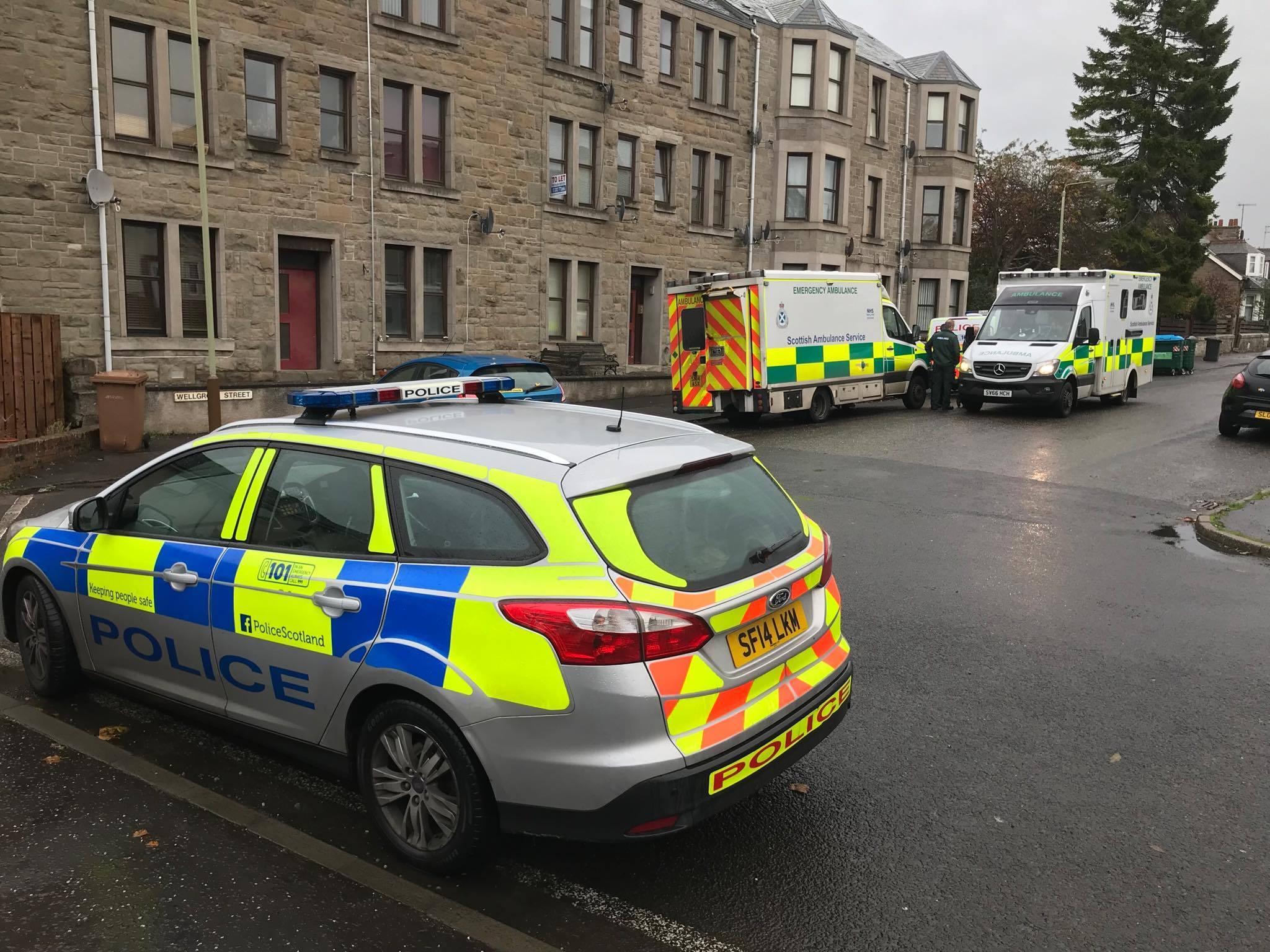 Police at the scene in Lochee.