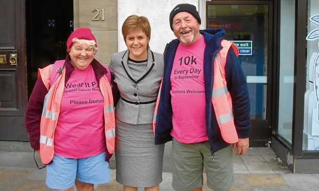 Margaret and Jim McHardy with Nicola Sturgeon on one of her visits to Dundee