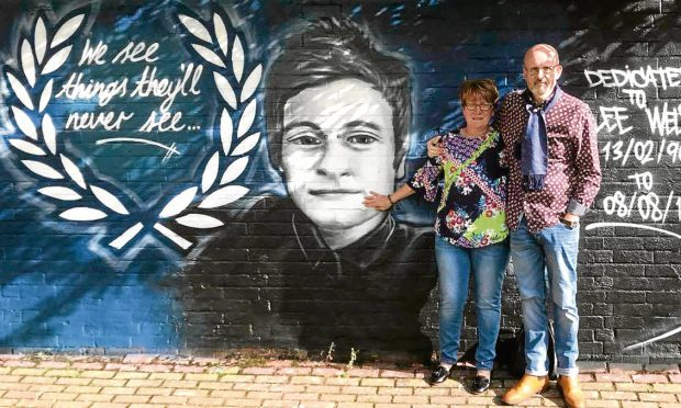 Lee Welsh's parents, Phil Welsh and Lesley Nicoll,  with an artwork tribute to their late son.