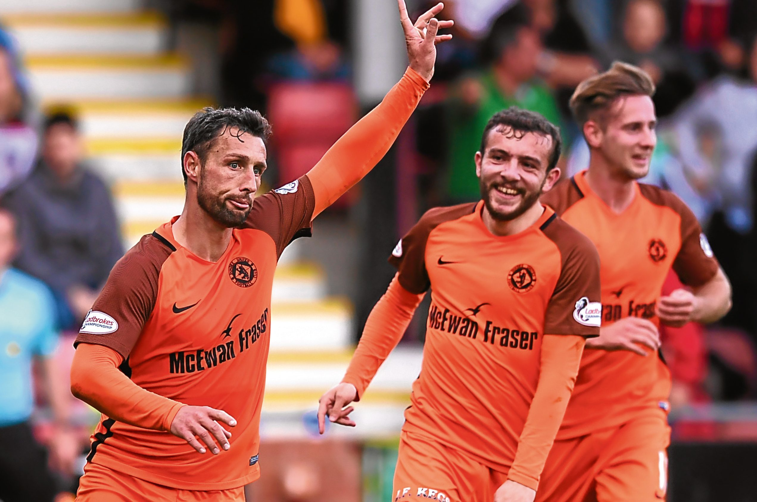 Dundee United attacker Scott McDonald makes it 2-0 against Dunfermline. The                 Tannadice men are beginning to find their form and are within touching distance of topping the Championship table.