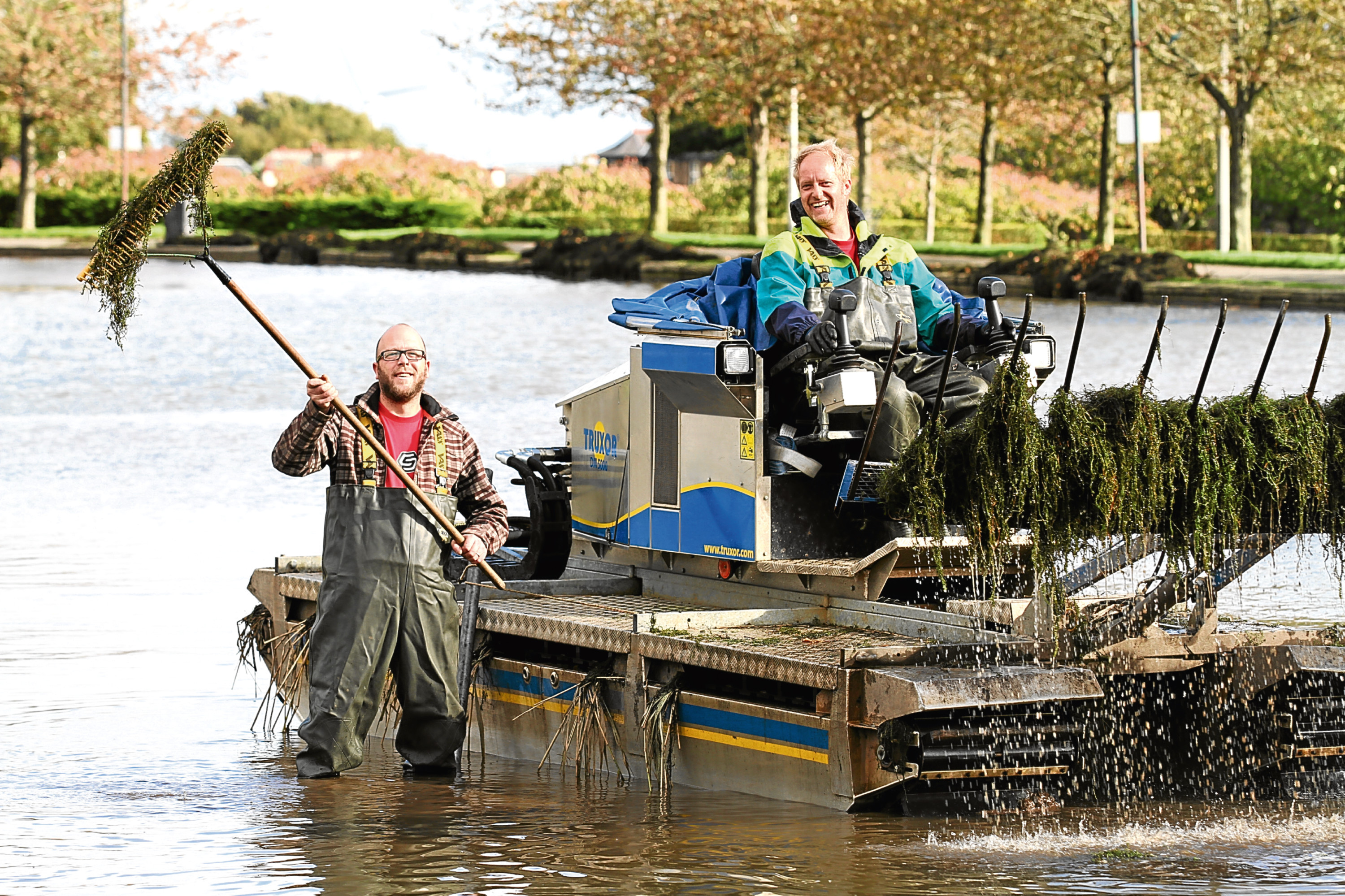 Operations manager Alan Smith and enviromental engineer Derrick Emms at work clearing red algae from Dundee's Swannie Ponds.