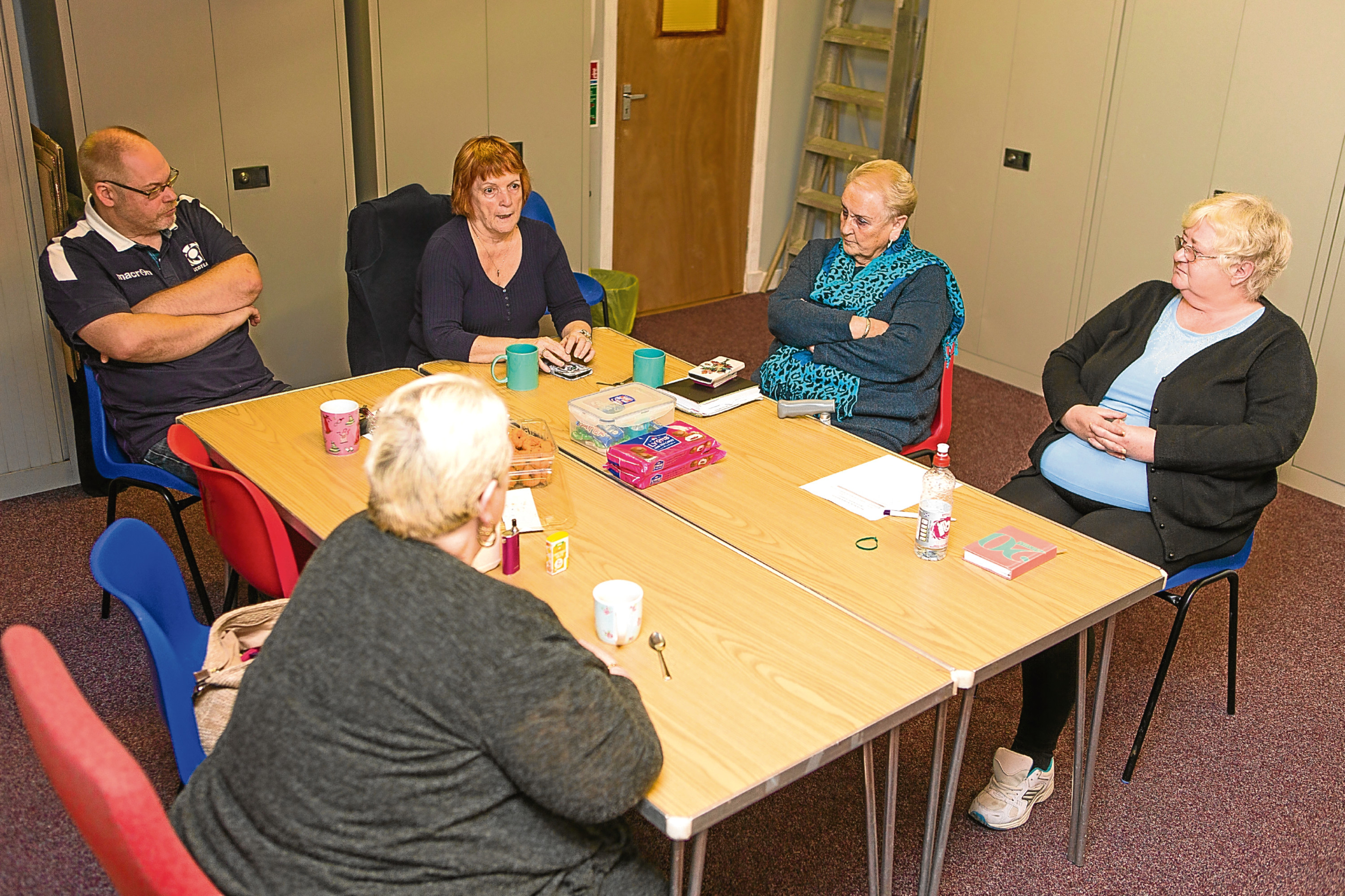 Dundee Mental Health Cairn Fowk group in a meeting.