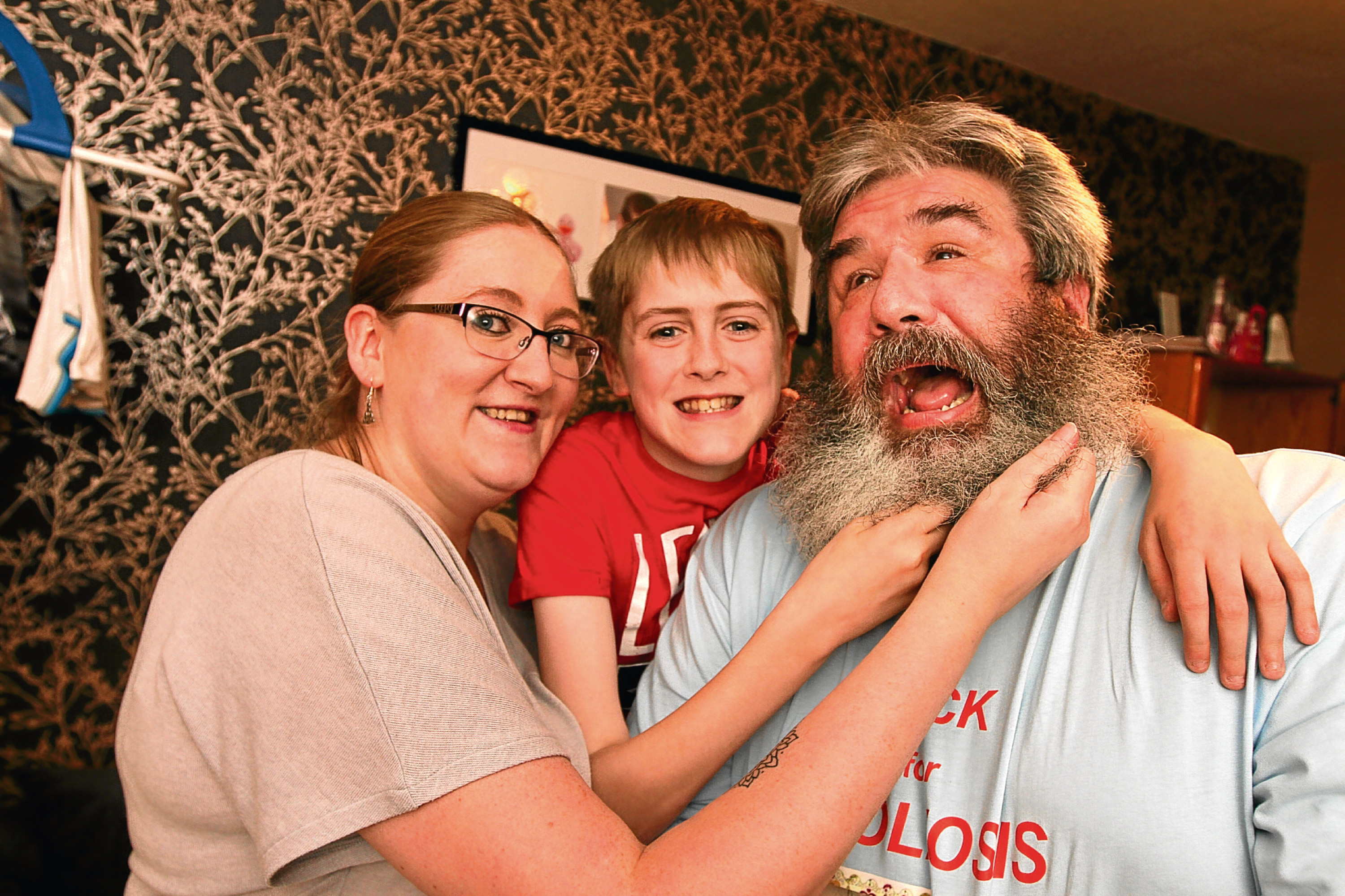 Nathan with his grandad Nick and mum Nikki. Nick has decided to go unshaven in a bid to raise cash for those who helped look after his grandson.