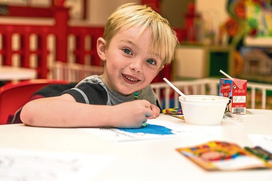 Six-year-old Andrew Burns at the Dundee Bairns breakfast club.