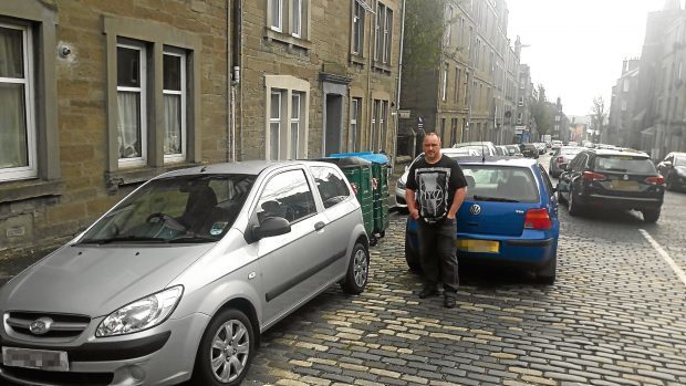 Malcolm Creegan has hit out at the parking situation on Morgan Street, where cars are parking in front of Eurobins.
