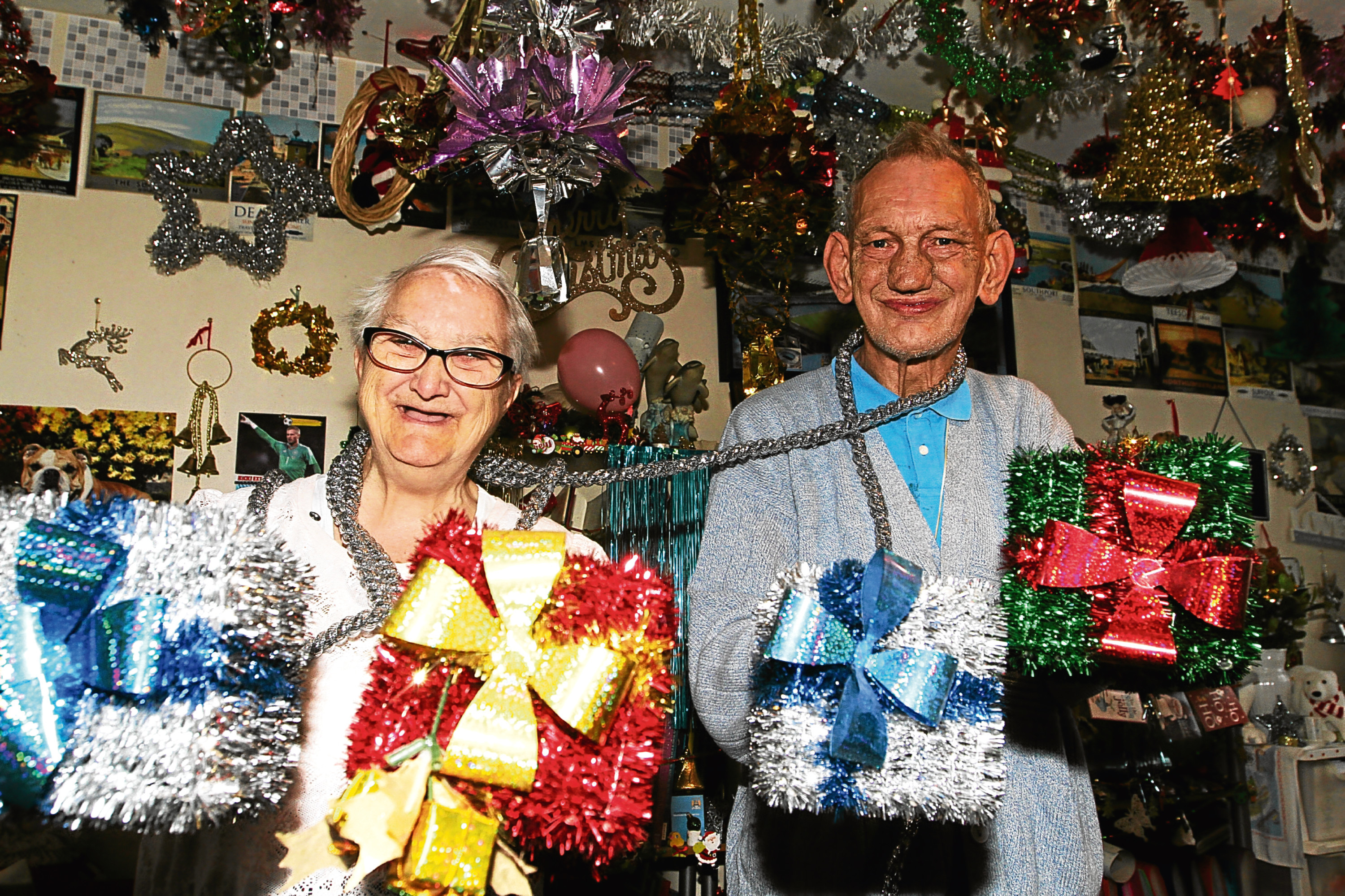 Bob and Valerie Heath show off their Christmas decorations.