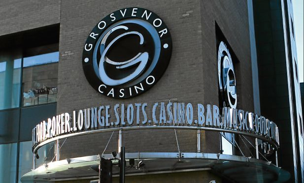John Scott pleaded guilty to assaulting Alexander Carr and Andrew Will of Police Scotland in the course of their duty by knocking them to the ground at the Grosvenor Casino, West Marketgait, on January 1.
