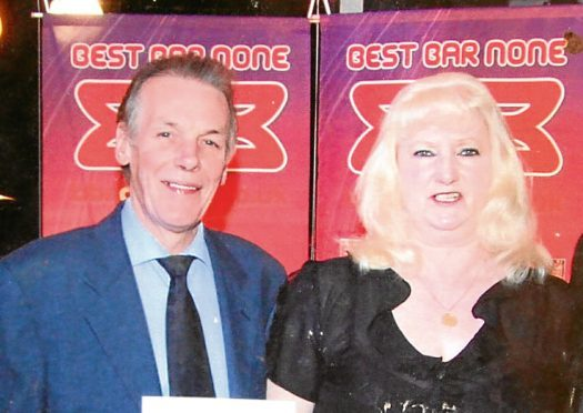 Eddie and Helen pick up an award for The Club Bar in 2008.