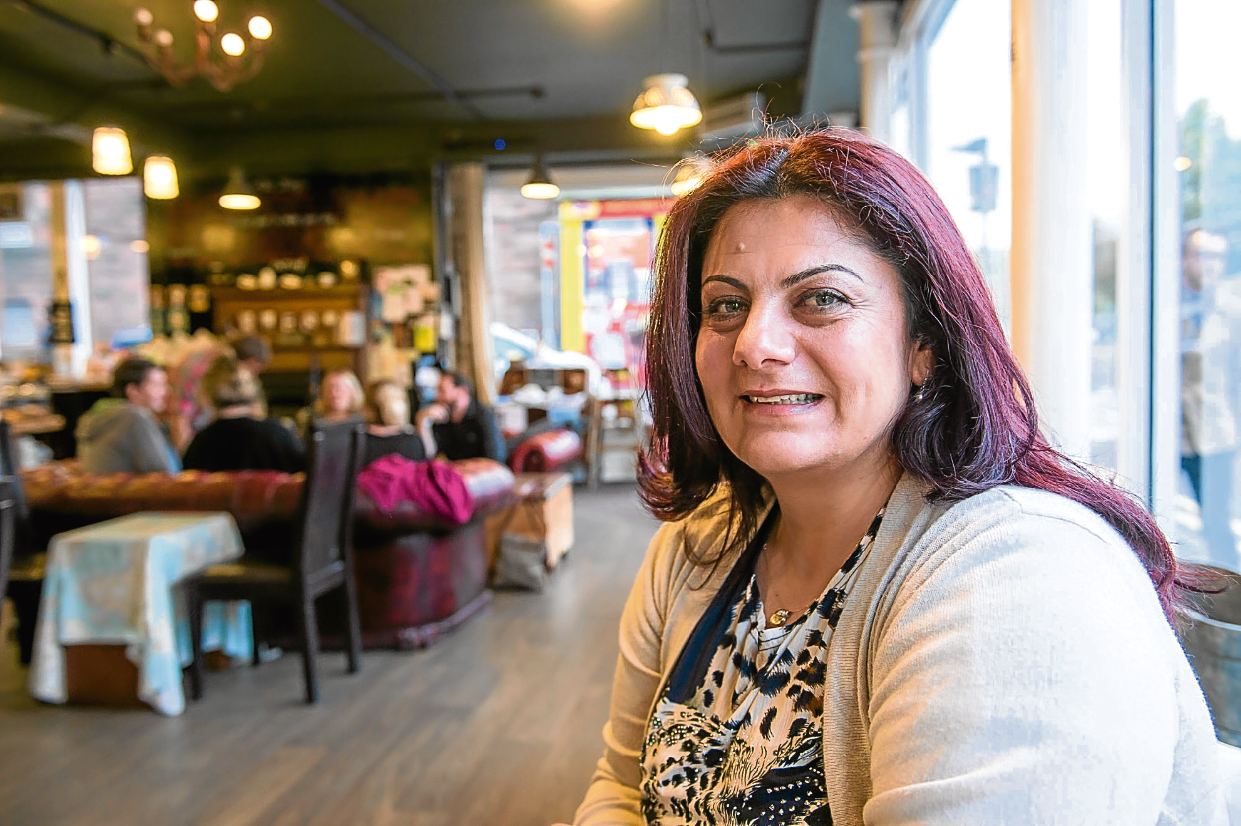 Perth woman Zabieh Shihada Alsamaan in the Fair City Blend coffee house, where the international cafe for foreign nationals holds its meetings.