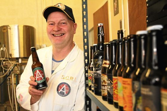 Law Brewing Company owner Danny Cullen with some of his beers