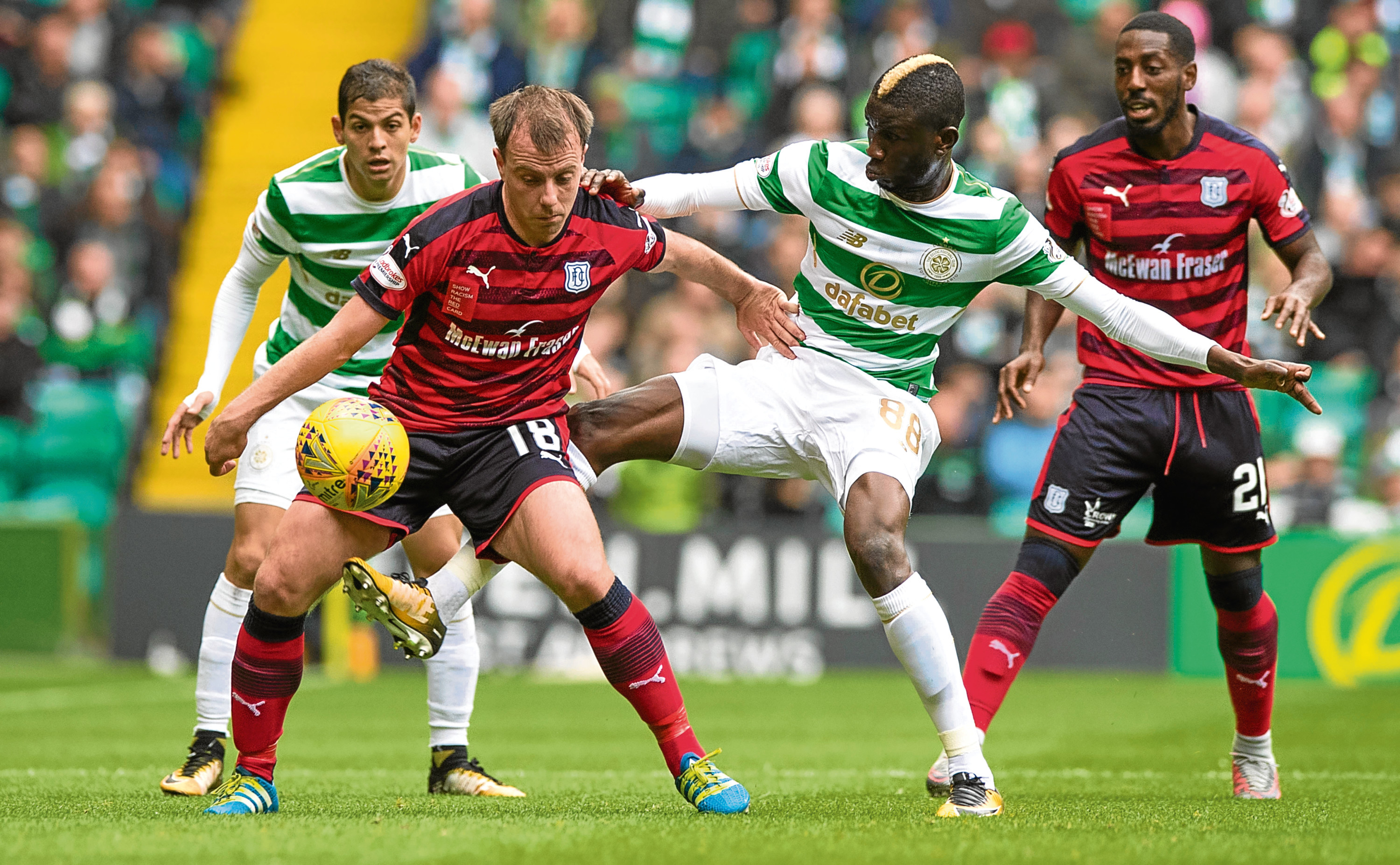 Paul McGowan in the thick of the action against Celtic last week.