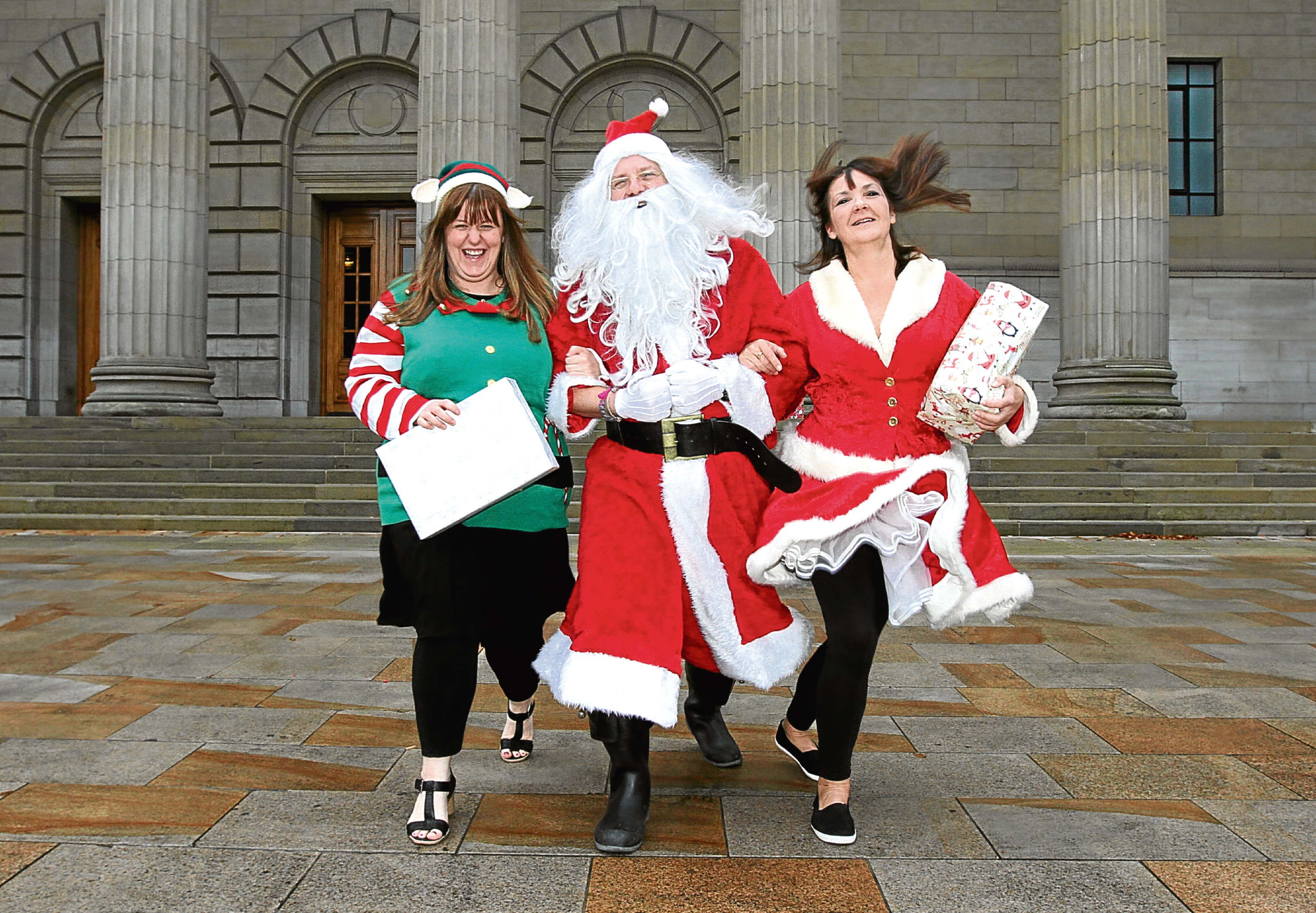 """Santa joined by """"elf"""" Kiley West and """"Mrs Claus"""", Nikki Bryce"""