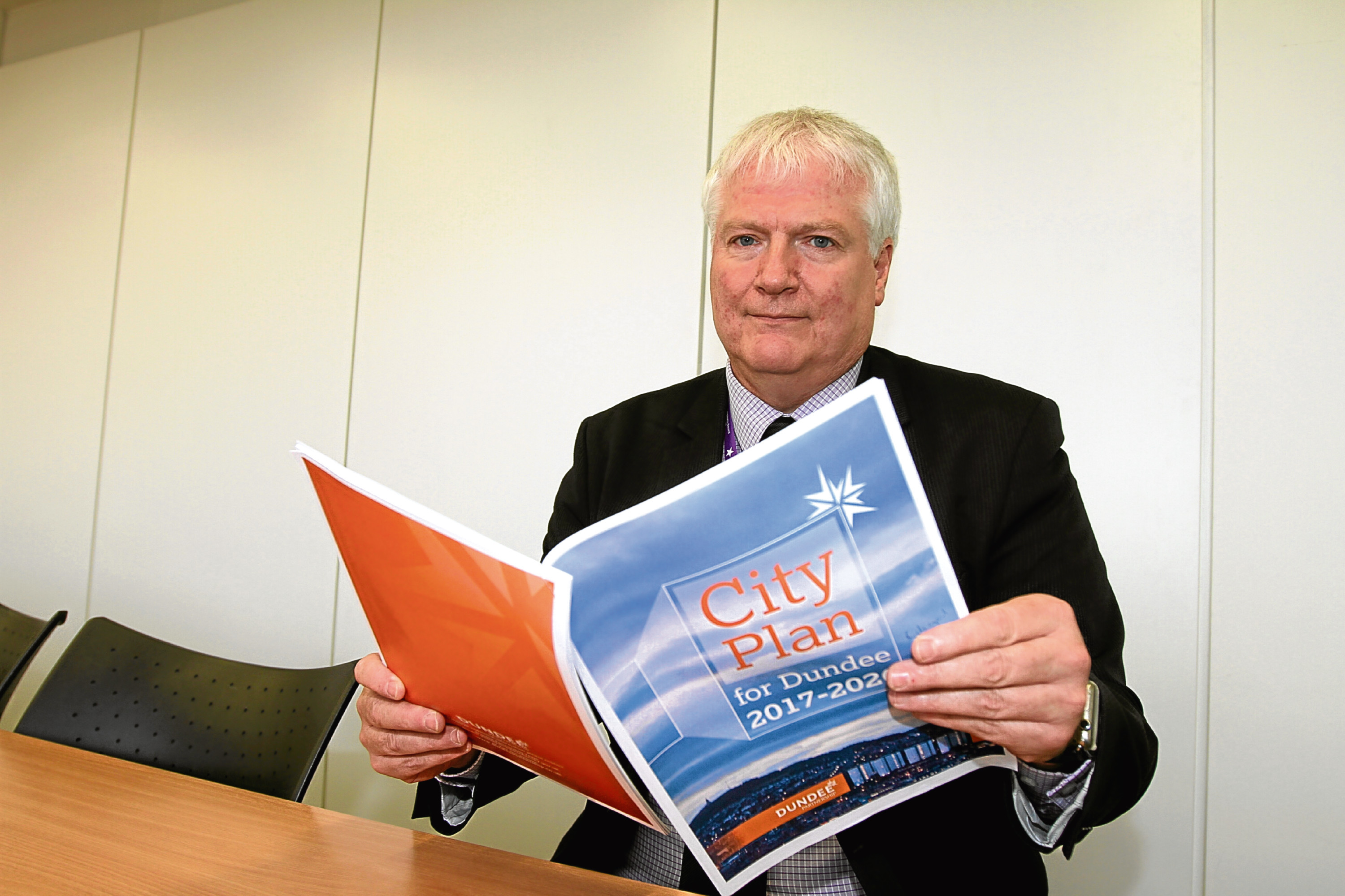 Paul Clancy with a copy of the Dundee City Plan