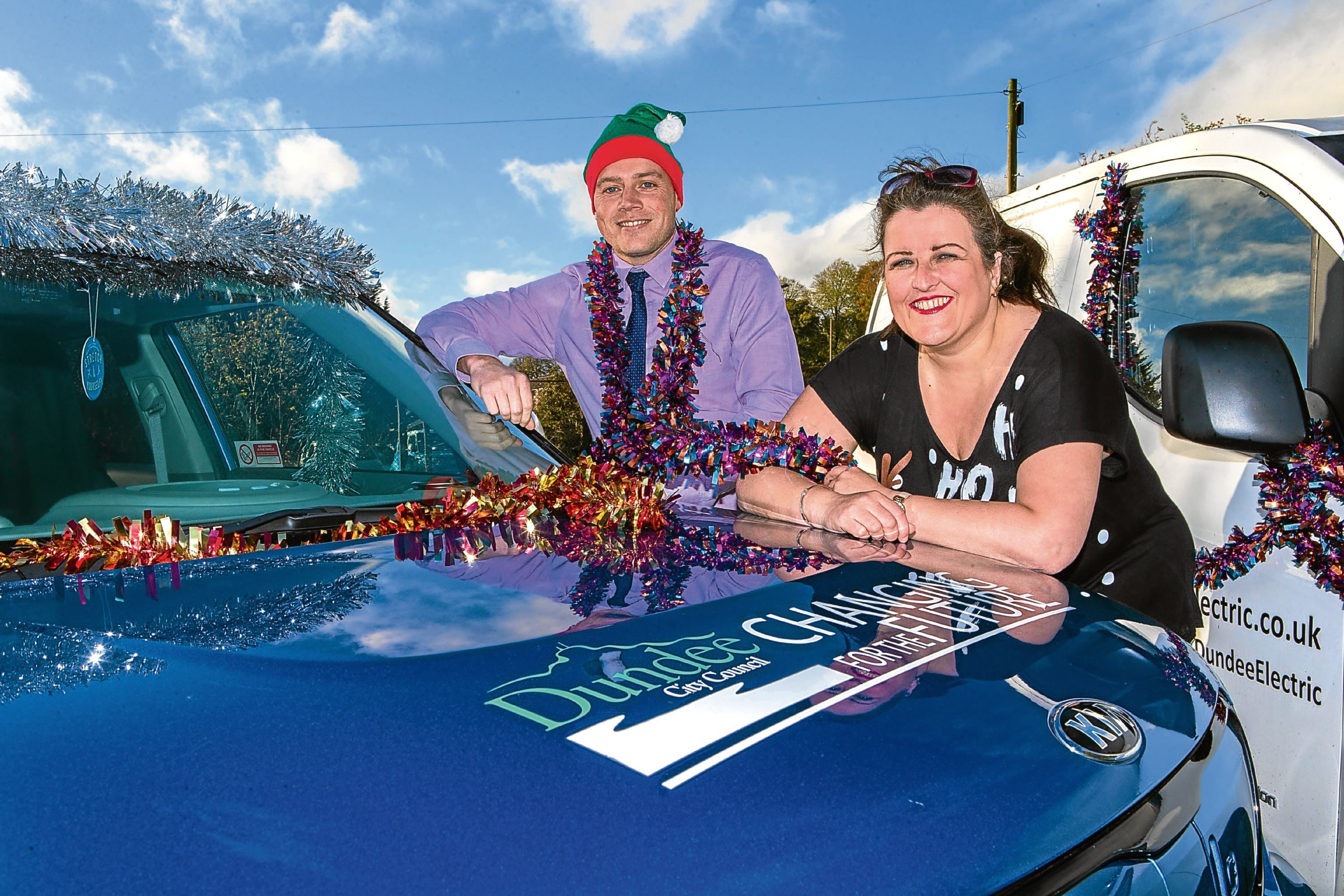 Councillor Lynne Short and Dundee council Transport co-ordinator Paul Menzies with the city's electric vehicles
